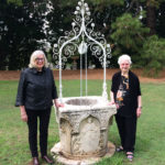 Margaret Betteridge and Lois Michel welcoming the return of the wishing well to Yaralla